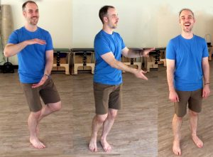 Scott Martin practicing QiGong moves and smiling