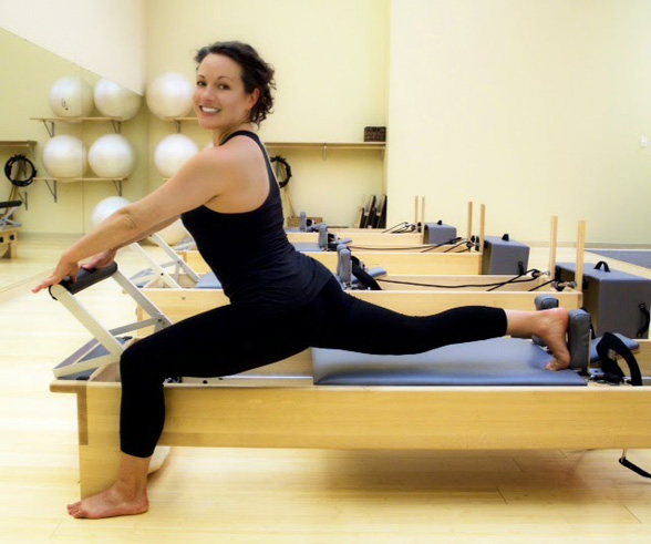 Haley, Pilates instructor at Jules Pilates on the reformer